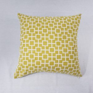 A yellow/white geometric cushion