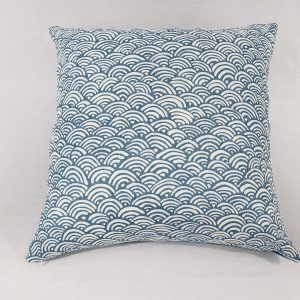 A contemporary blue wave cushion with blue wool back