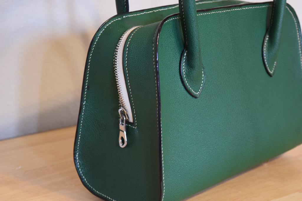 Chagrin bag with spine detail