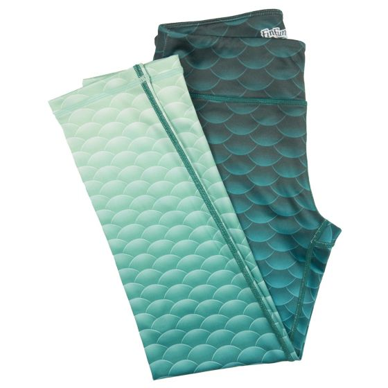 Mermaid Leggings. Show off your mermaid style on land with Fin Fun's sporty mermaid scale leggings featuring a gorgeous pattern of tranquil, ombre mermaid scales. Combine these super soft and comfortable leggings with a matching Fin Fun tee or raglan top to create the perfect casual outfit. Retails for $24.95.