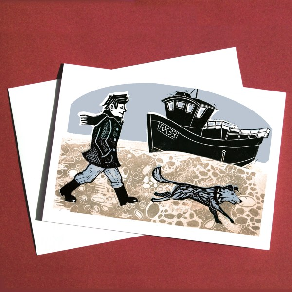 linocut of man walking his dog on the beach