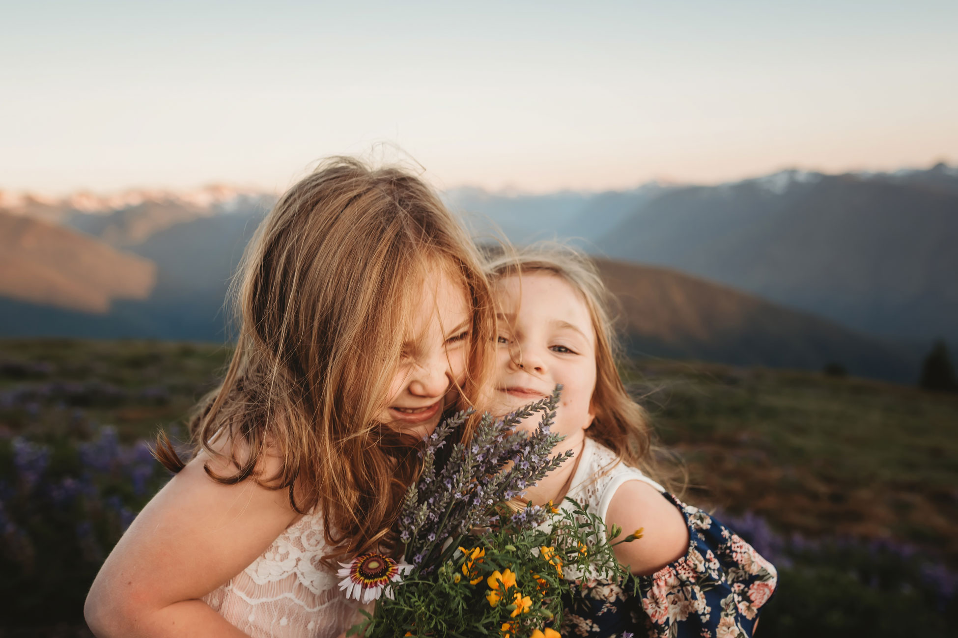 sister snuggling during seattle family photography session