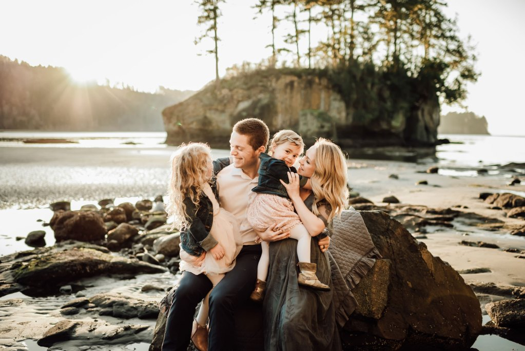 cute family snuggling on beach at seattle family photography session