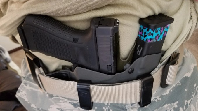 clips or loops holster attachment comparison firearm rack