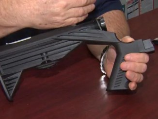 """Essex Police Chief Peter Silva held up a bump stock that someone turned in this week as the Massachusetts ban on the devices went into effect. """"To my knowledge, this is the only one that's been turned in to date,"""" he said. State Police said they received three bump stocks and one trigger crank, as Massachusetts now becomes the first state in the country to make the devices illegal."""
