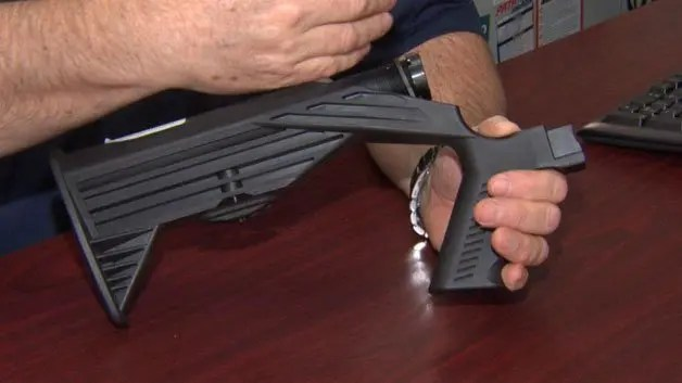 "Essex Police Chief Peter Silva held up a bump stock that someone turned in this week as the Massachusetts ban on the devices went into effect. ""To my knowledge, this is the only one that's been turned in to date,"" he said. State Police said they received three bump stocks and one trigger crank, as Massachusetts now becomes the first state in the country to make the devices illegal."