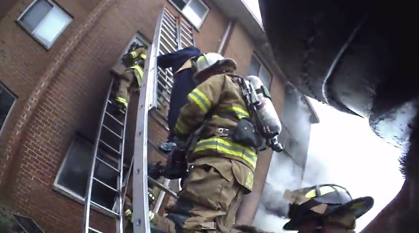 Helmet Cam Firefighters Rescue Women By Ground Ladder And