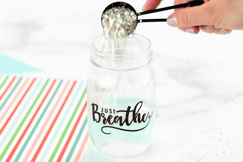 Pouring Glitter into Glitter Jar