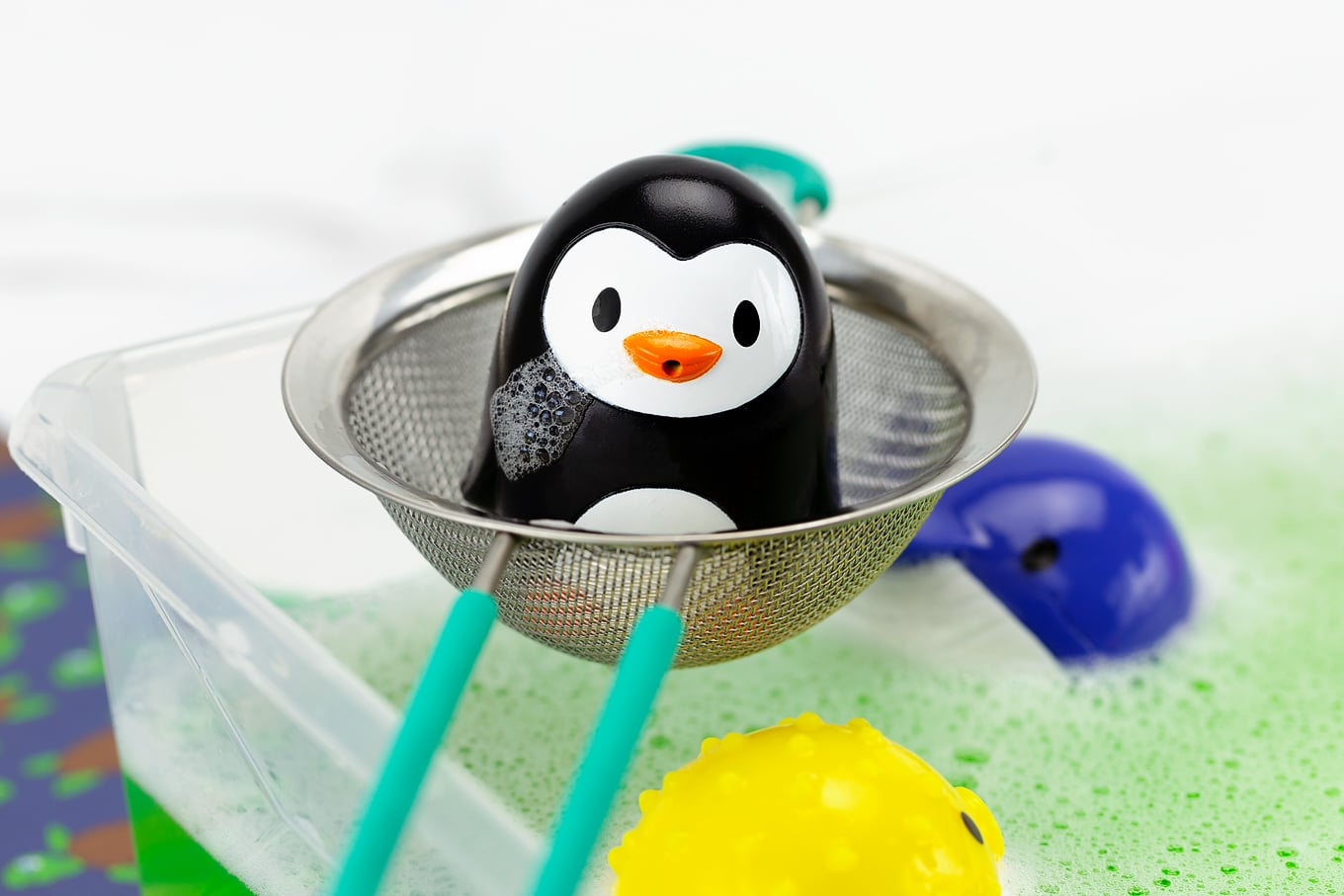 Penguin Bath Squirter on a Strainer