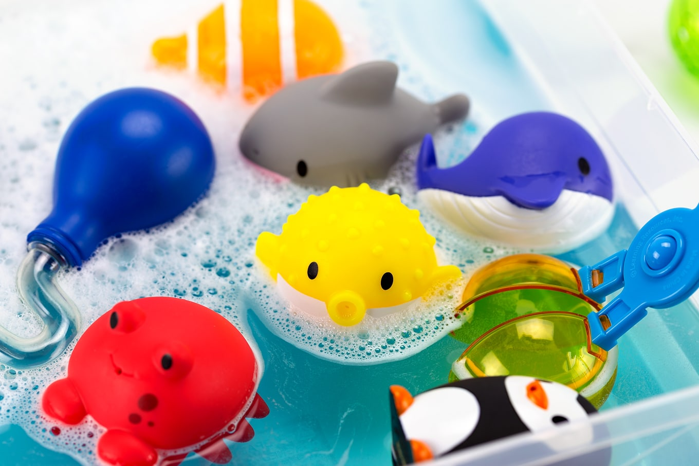 Colorful Bathtub Squirters in a Bubbly Water Sensory Bin