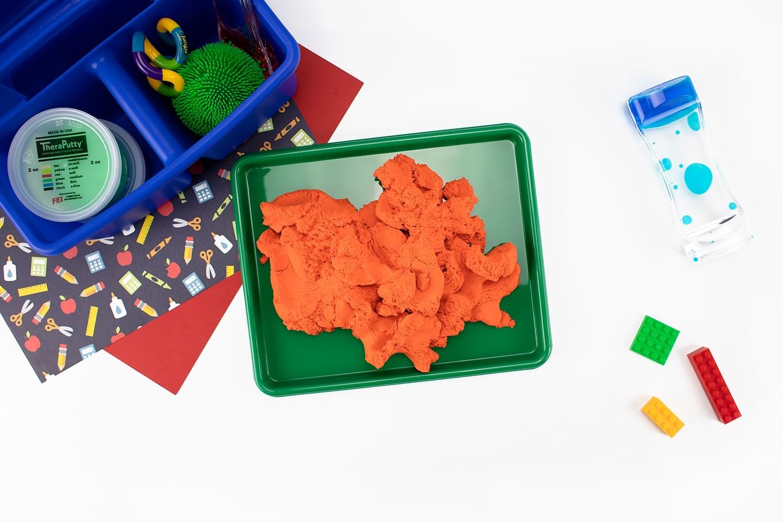 Orange Sensory Material on a Green Tray