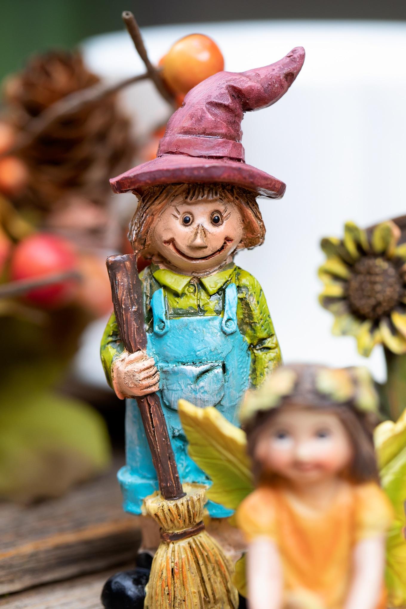 Resin Scarecrow in Fall Teacup Garden