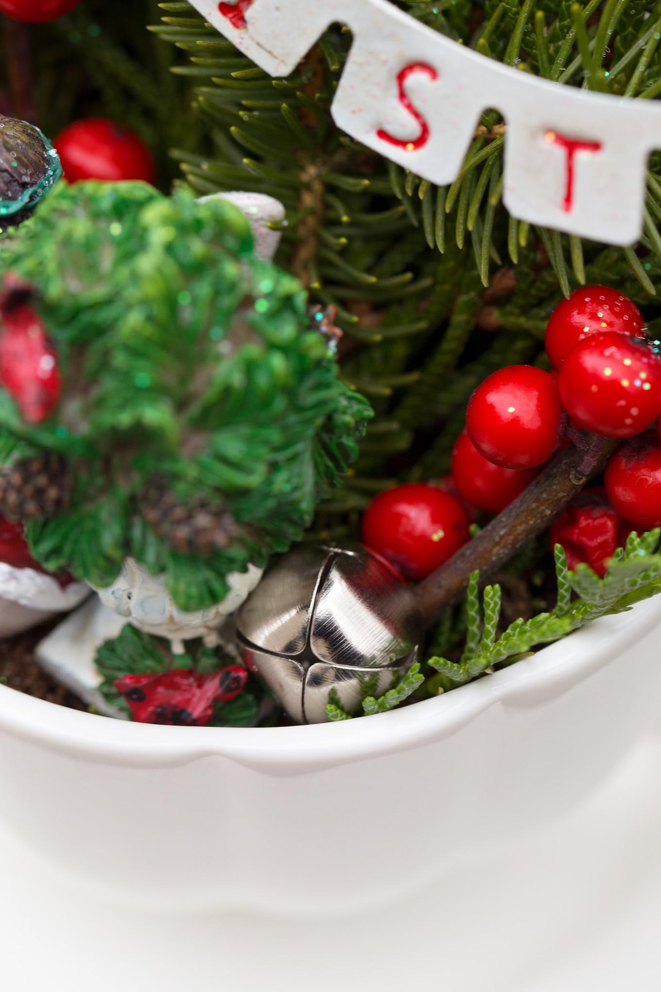 A Tiny Jingle Bell in a Christmas Teacup Garden