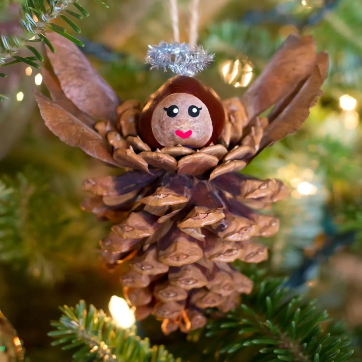 Pinecone Angel Ornaments are a charming Christmas nature craft for kids.  This ornament is simple