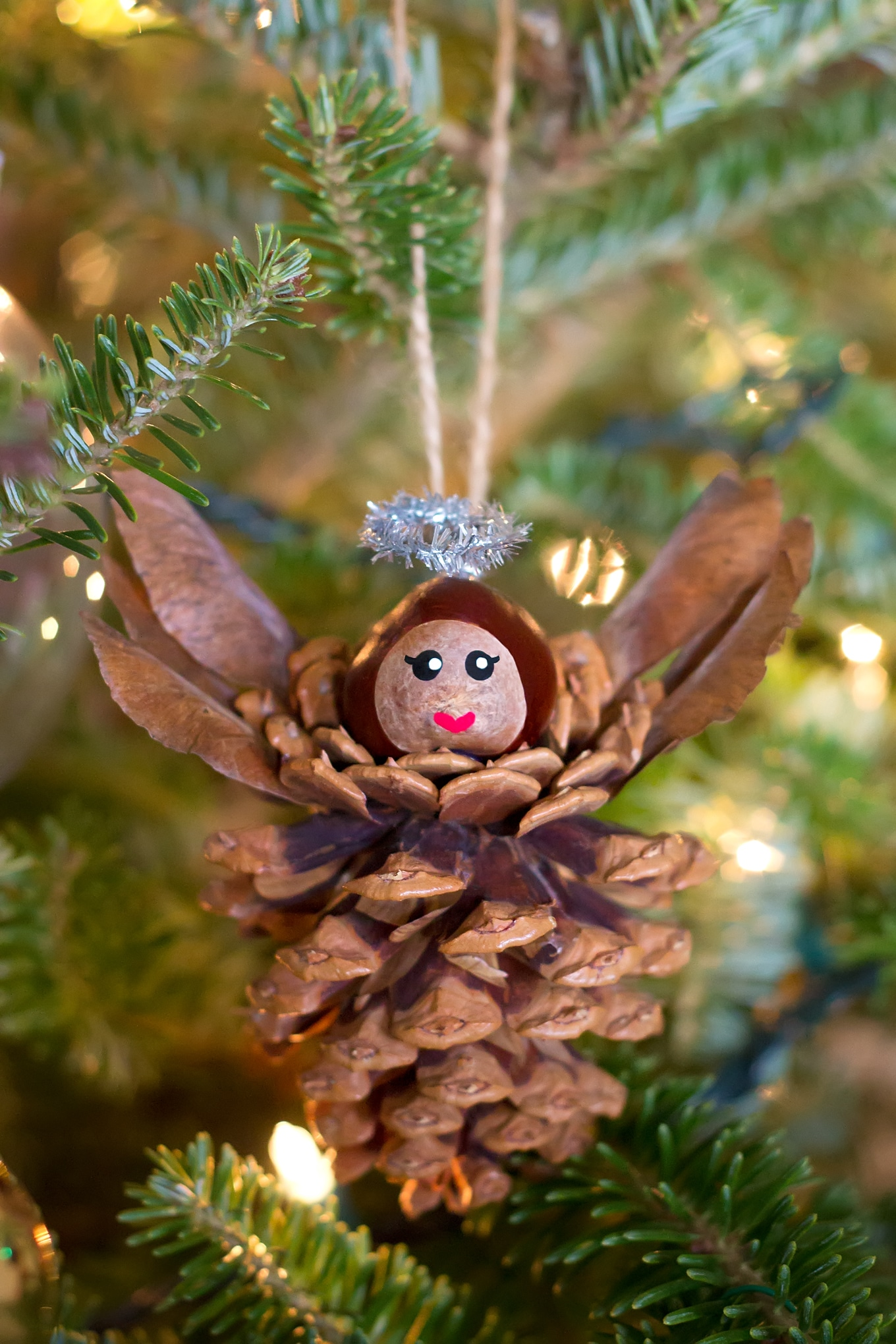 Pinecone Angel Ornaments are a charming Christmas nature craft for kids. This ornament is simple, sweet, and fun for crafters of all ages.