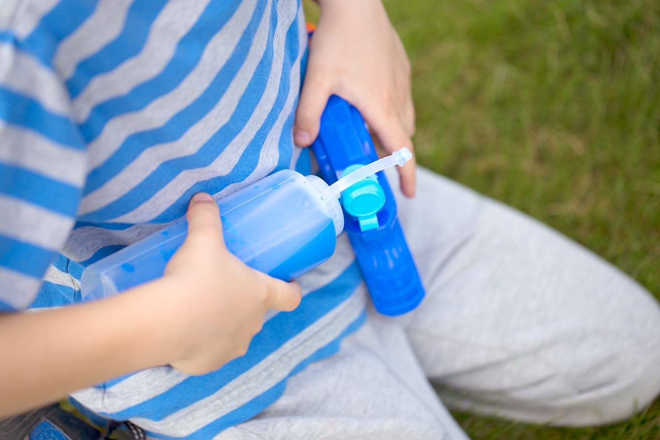 Child Filling Squirt Gun for Squirt Painting