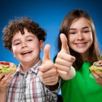 bigstock-Kids-eating-healthy-sandwiches-41747542