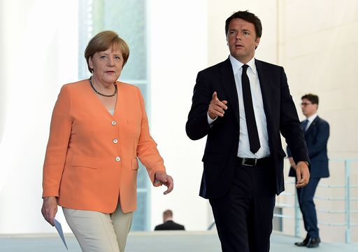 German Chancellor Merkel and Italian Prime Minister Renzi arrive for a press conference on July 1, 2015 at the chancellery in Berlin.  AFP PHOTO / JOHN MACDOUGALL