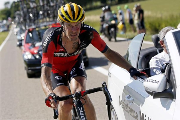 epa04834279 BMC Racing Team rider Daniel Oss of Italy receives medical assistance following a crash at the bottom of the Cote de Bohissau near Andenne, Belgium, 06 July 2015, during the 3rd stage of the 102nd edition of the Tour de France 2015 cycling race over 159.5km between Anvers and Huy, Belgium.  EPA/YOAN VALAT