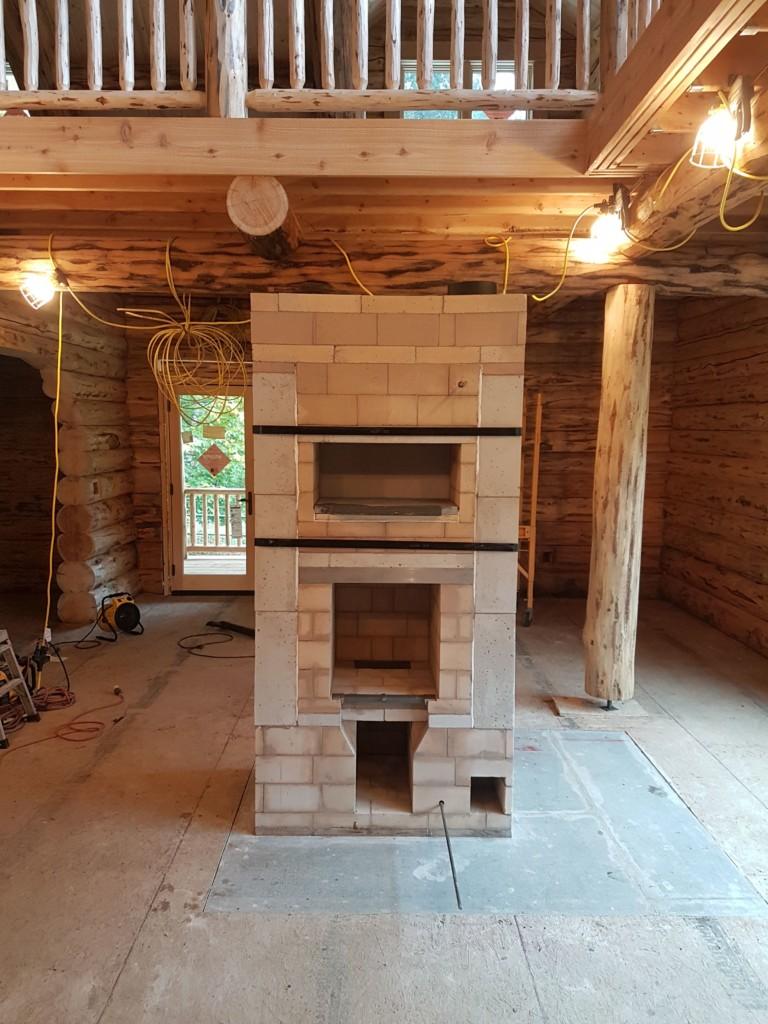 Lost Creek Masonry Heater with White Oven, Wood Storage, Heated Bench, Ledge Stone