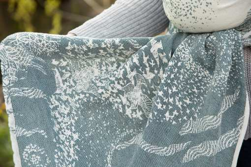 white and teal green linen blend woven wrap with a birds design