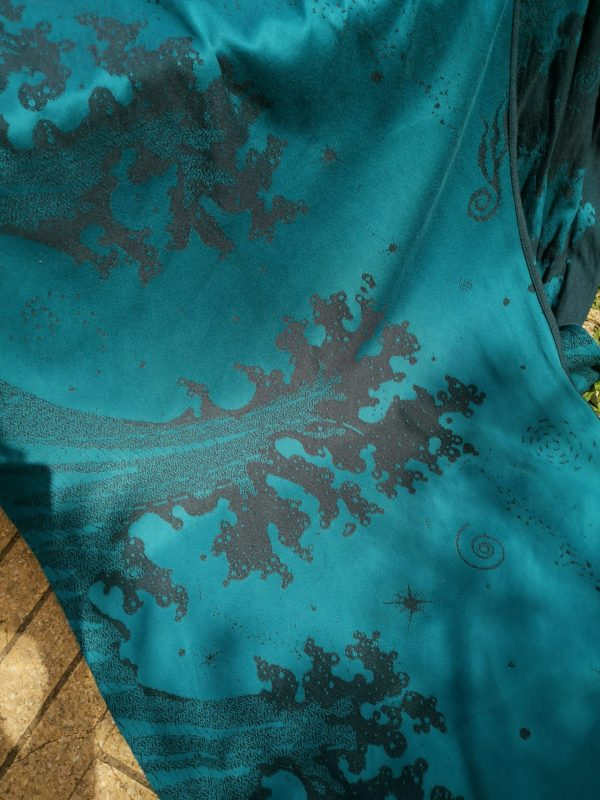 navy blue and teal jacquard woven fabric featuring crashing waves