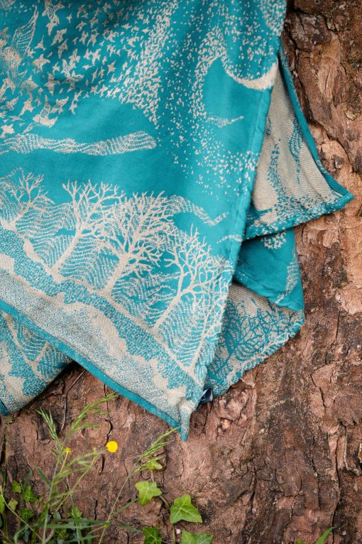 teal and gold linen blend woven wrap with birds and trees design