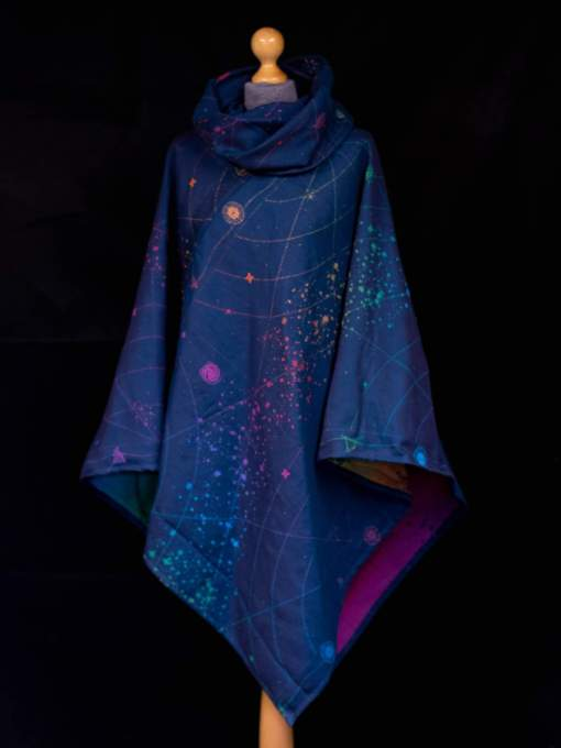 Navy and rainbow poncho made from organic combed cotton with a starmap design