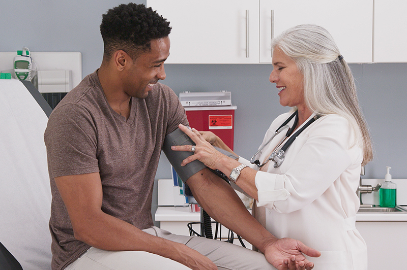 Female doctor checking a patient's blood pressure