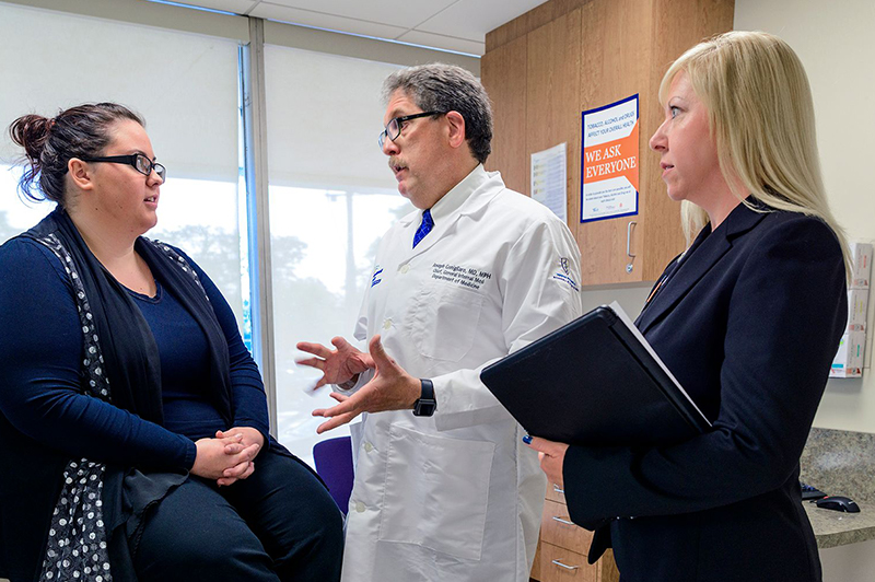 Doctor and nurse discussing with a patient
