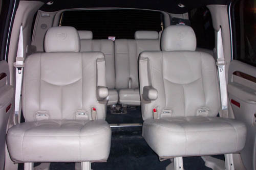 low back chairs for concerts yellow club chair first class limos - cadillac escalade limousine limo