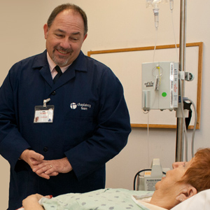 Chaplain Robert Henderson meets with a patient