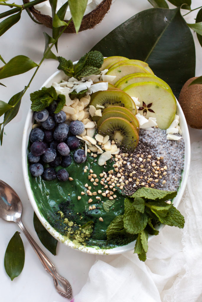Green smoothie bowl with frozen blueberries and chis seed pudding