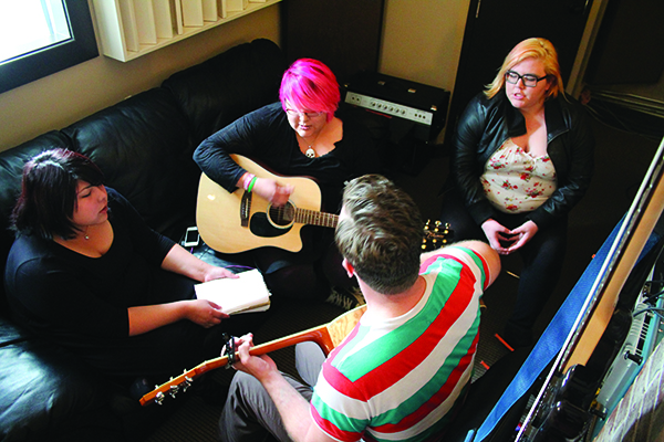 "From L to R: Taylor May, Shayne May, Ashley Buchholtz of U.S.S. and Kira Assiniwe working on ""Drowning"" in the Coalition Music Studios."