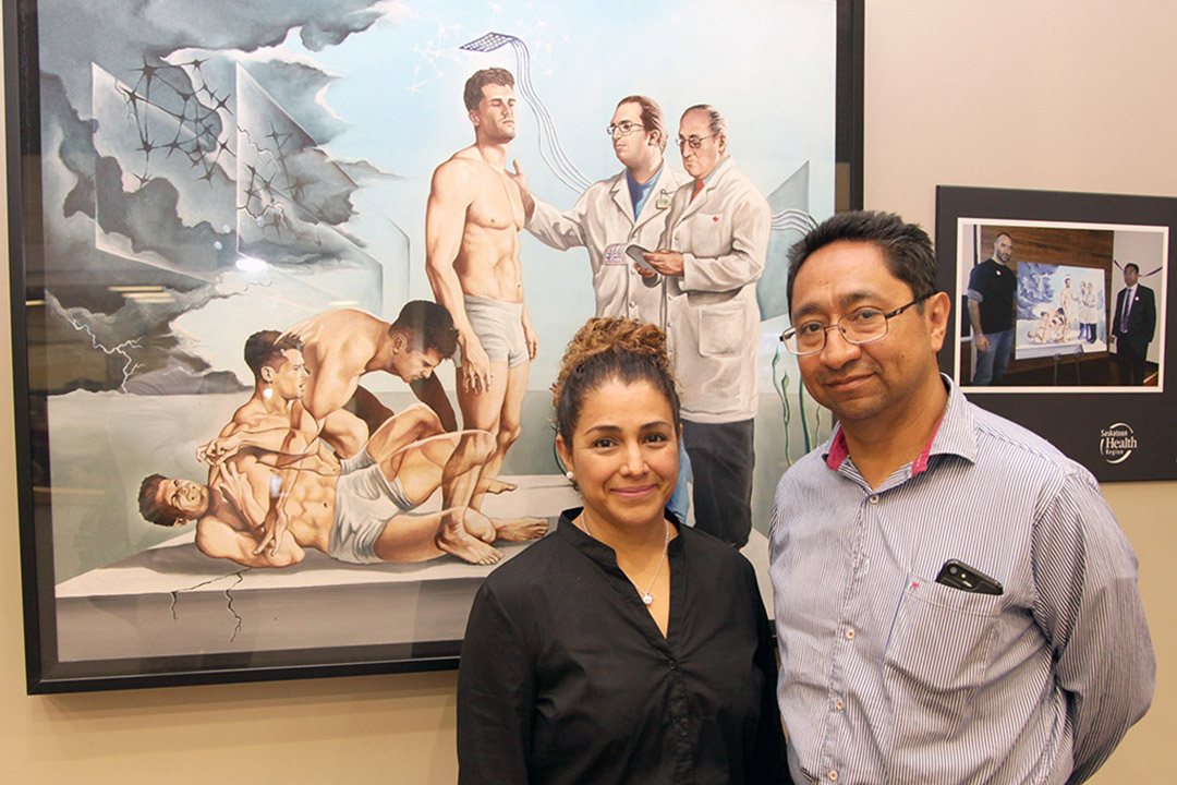 Dr. Lizbeth Hernández-Ronquillo (left) and Dr. Jose Téllez-Zenteno, in front of Mexican artist Eduardo Urbano Merino's painting Epilepsy, leaving the nightmare behind (2013), representing epilepsy surgery. (Photo by Daniel Hallen, University of Saskatchewan)