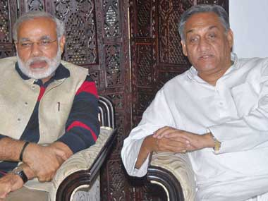 Uttarakhand Chief Minister Vijay Bahuguna talks with his Gujarat counterpart Narendra Modi about relief work, in Dehradun on Saturday. PTI