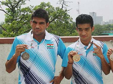 Mandeep Jangra (left), and Shiva Thapa with show off their medals from the Asian Boxing Championships. PTI