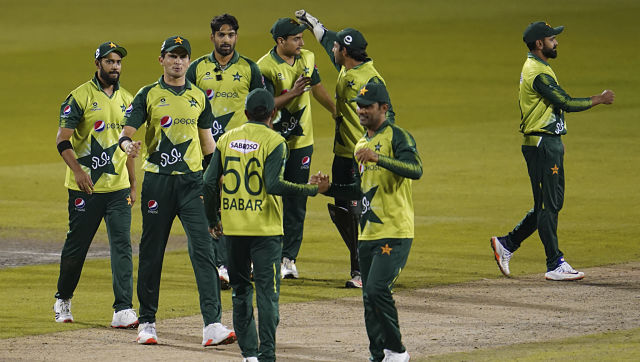 Pakistan players celebrate their win in the third Twenty20 cricket match between England and Pakistan, at Old Trafford in Manchester, England, Tuesday, Sept. 1, 2020. (AP Photo/Jon Super, Pool)