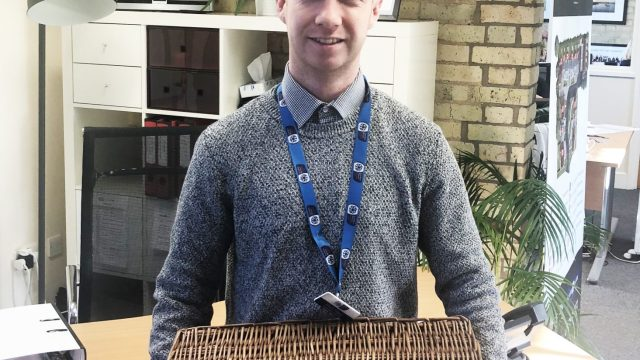 Harry from Garden House Hospice came in to collect the Luxury Hamper donation