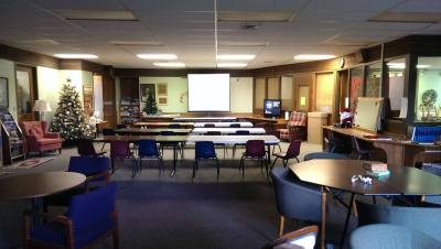 Picture of the library space setup for a class with projection screen