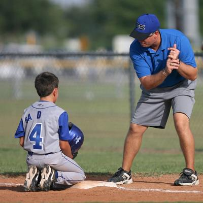 picture of a baseball coach and youth player