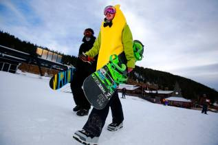 Connor Anderson dressed in a banana costume and Sam Schuler in a gorilla costume, both from Westminster, Colo., walk to the lift line for opening day today at Loveland Ski Area (photo: Jack Dempsey/CSCUSA)