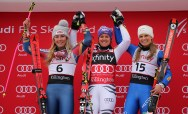 U.S.A.'s Mikaela Shiffrin (second place), Germany's Viktoria Rebensburg (first place) and Italy's Manuela Moelgg (third place)on the podium after the women's Audi FIS Ski World Cup giant slalom race at Killington in Vermont on Saturday, November 25, 2017. (FTO photo: Martin Griff)