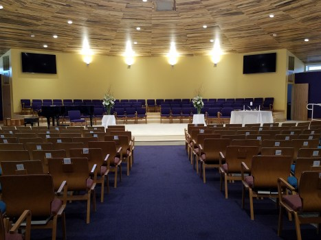 Sanctuary or auditorium space with chairs and soaring beetle-kill pine ceiling