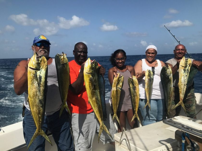 Charter group holding a nice catch of dolphin just caught on our sportfish charter.