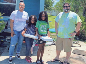 newss letter may 2020, group leaders deliver packages to students