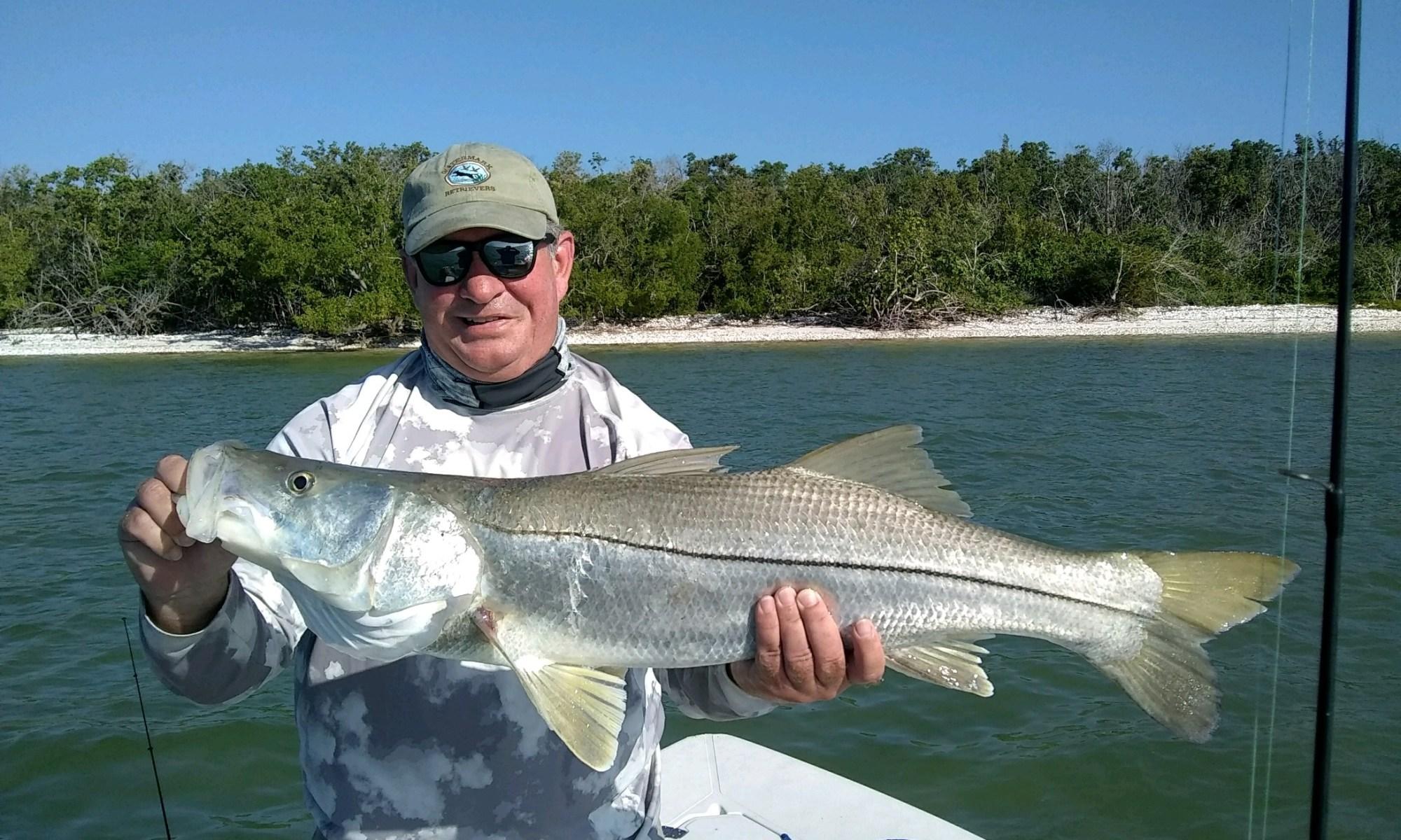 Angler holding Snook