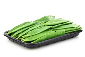 Uncovered trays filled with snow peas