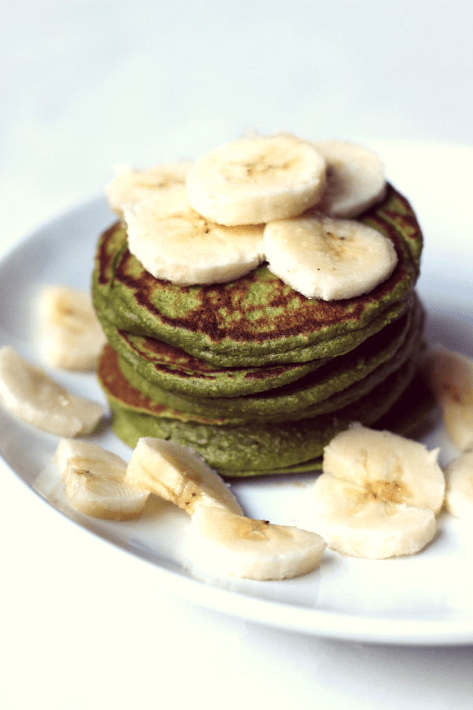 Stack of Spinach banana pancakes with sliced bananas