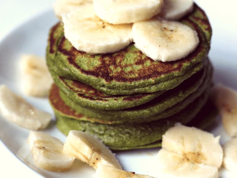 Stack of Spinach banana pancakes with sliced bananas